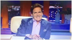 Mark Cuban looking uncomfortable on Shark Tank as during a presentation